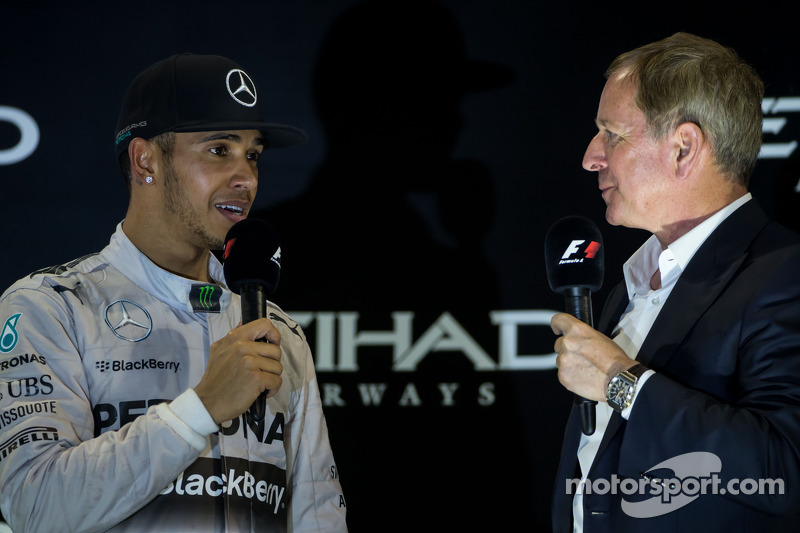 (L to R): Race winner and World Champion Lewis Hamilton, Mercedes AMG F1 on the podium with Martin B