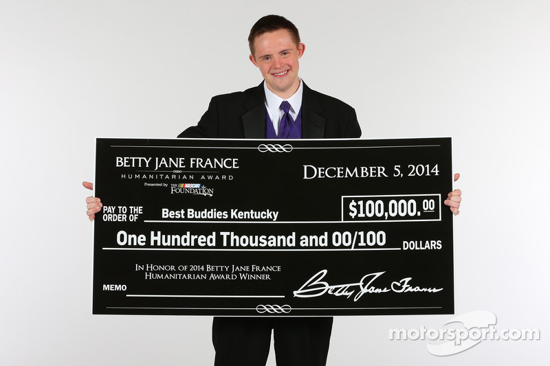 Daniel Noltemeyer poses with the check for the Fourth Annual Betty Jane France Humanitarian Award