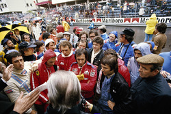 Drivers attend the briefing before the race: Carlos Pace, Niki Lauda, John Watson, Jochen Mass, Emerson Fittipaldi, Vittorio Brambilla, Tom Pryce and Jean-Pierre Jarier