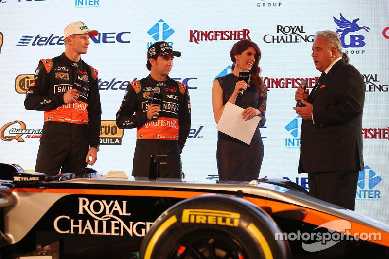 (从左到右)尼克·胡肯伯格,印度力量车队和塞尔吉奥·佩雷斯,印度力量车队,和维杰·玛尔雅,印度力量车队老板