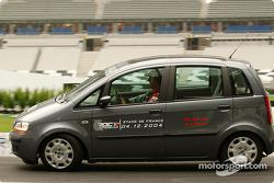 Michael Schumacher drives a Fiat Idea around the track