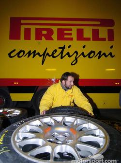 Pirelli crew member prepares the tires