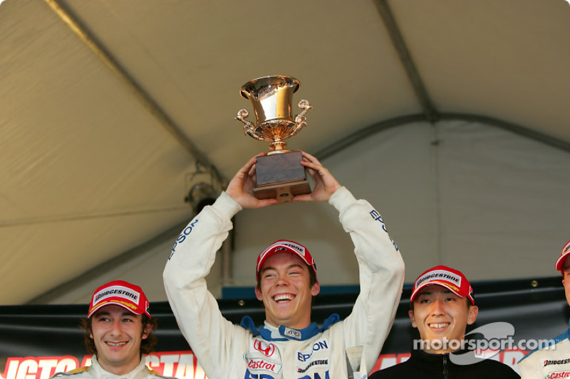 GT500 podium: race winner Andre Lotterer holds the trophy