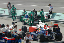 A.J. Foyt IV and Alex Barron on the starting grid