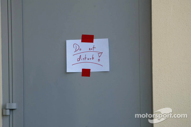 Closed door on a press conference of Michael Schumacher after retiring from the race
