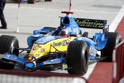 Race winner Fernando Alonso arrives in Parc Fermé