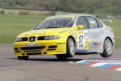 #57 SEAT Sport UK SEAT Toldeo Cupra of Luke Hines bounces the kerbs