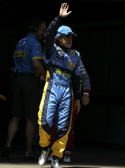 Fernando Alonso waves to his fans after his qualiyfing run