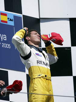 Podium: race winner Jose Maria Lopez celebrates
