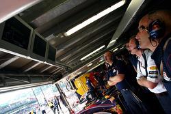 Red Bull Racing crew members watch qualifying
