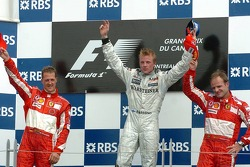 Podium: race winner Kimi Raikkonen with Michael Schumacher and Rubens Barrichello