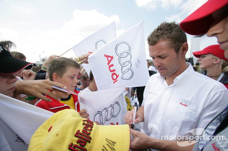 Tom Kristensen signs autographs