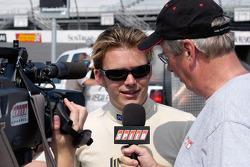 Indy 500 winner Dan Wheldon is interviewed by Robin Miller