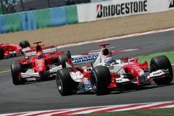 Jarno Trulli and Michael Schumacher