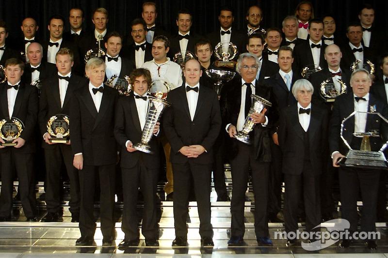 Max Mosley, Fernando Alonso, Albert of Monaco, Flavio Briatore and Bernie Ecclestone pose with the 2005 FIA winners