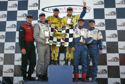 Podium: race winners Bill Auberlen and Justin Marks, with Spencer Pumpelly and Tim Gaffney, and Mike Keravich III and Owen Trinkler