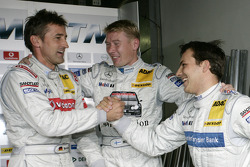 Pole winner Gary Paffett celebrates with Mika Hakkinen and Bernd Schneider