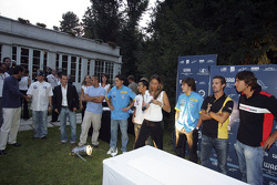 The F1 Drivers prepare for the hand-printing for the auction