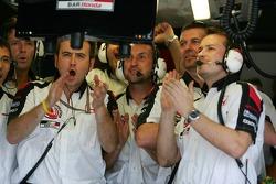 BAR-Honda team members watch qualifying lap of Jenson Button