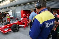 Michelin engineer watches Ferrari pitbox