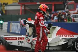 Michael Schumacher and Takuma Sato after their crash