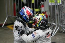 Race winner Juan Pablo Montoya with Kimi Raikkonen