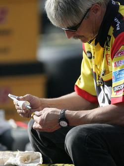 Cat Dodge crew member prepares wheels