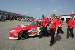 Motorcraft Ford crew members push the car to qualifying line