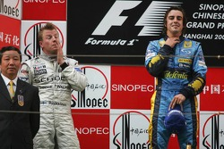 Podium: race winner Fernando Alonso celebrates with Kimi Raikkonen