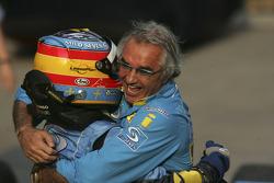 Race winner Fernando Alonso celebrates with Flavio Briatore
