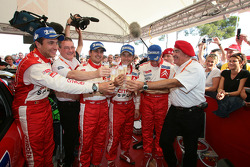 Rally winners Sébastien Loeb and Daniel Elena celebrate with François Duval, Sven Smeets and Guy Fréquelin