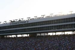 The sun sets behind the spotters high above Texas Motor Speedway