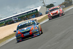 Marcos Ambrose leads Garth Tander