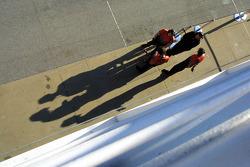 Mechanics wait in the pitlane