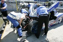 Tracy Krohn helps his crew