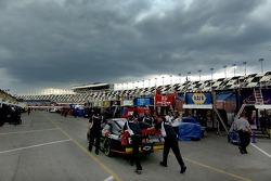 Denny Hamlin crew pushes car through garage area