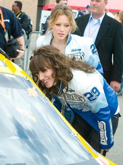 Hillary Duff and her sister Haylie Duff get their first look at the cockpit of a NASCAR race car