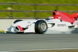 Team Indoesia driver Ananda Mikola locks up the front wheel under braking