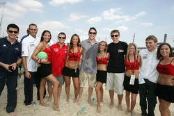 Beach volley match: drivers pose with the Bacardi girls
