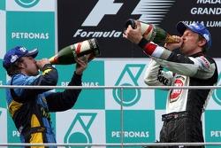 Podium: champagne for Giancarlo Fisichella and Jenson Button