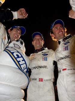 GT1 class winners Oliver Gavin, Jan Magnussen and Olivier Beretta