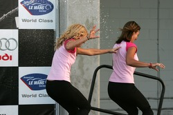 Speed girls run away from the champagne celebration