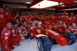 Race winner Michael Schumacher celebrates with this team