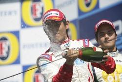 Podium: Hiroki Yoshimoto sprays champagne