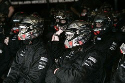 Midland F1 Racing team members watch the race