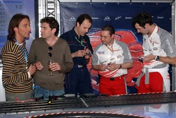 Chilled Thursday: Daniele Casanova with visitors and Toyota engineers play with carrera remote control cars