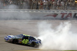 Race winner Jimmie Johnson celebrates with a burn out