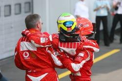 Race winner Michael Schumacher celebrates with Ross Brawn and Felipe Massa