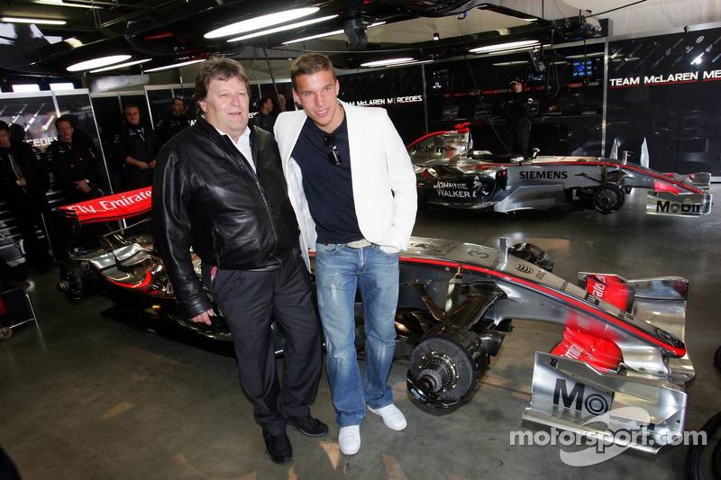 Lukas Podolski et Norbert Haug