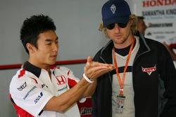 Takuma Sato and actor Owen Wilson promoting new animated film